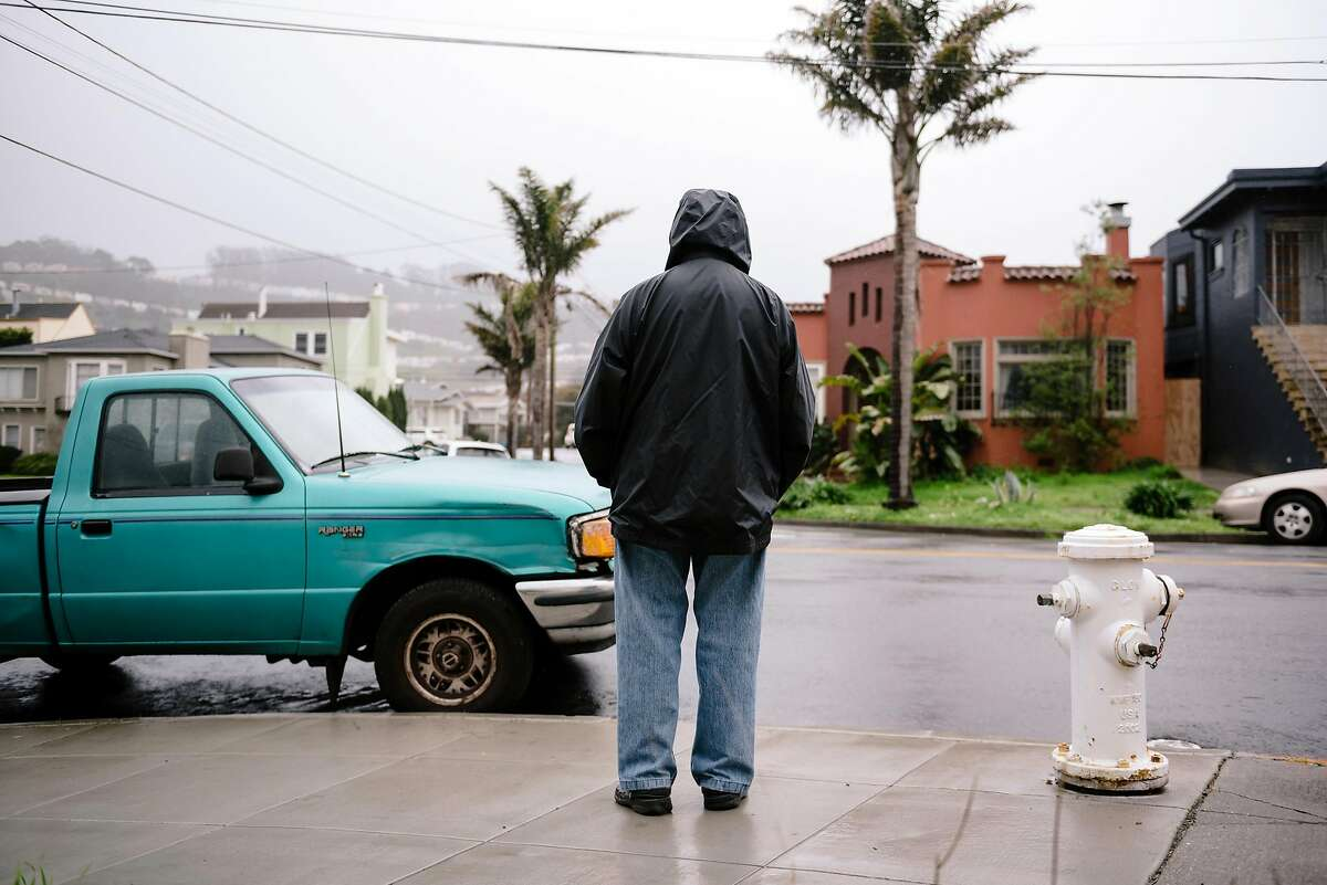 Anthony De Guzman stands for a portrait next to the parking spot where left his car parked and received a ticket while he was in the hospital for two weeks after being robbed and stabbed on the steps of his home in San Francisco, Calif, on Tuesday, January 28, 2020.
