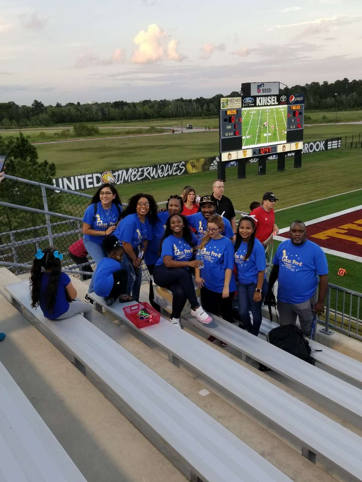 Quarde Alfred gathers with other BISD staffers at a football game at Beaumont Memorial Stadium. Photo courtesy of BISD