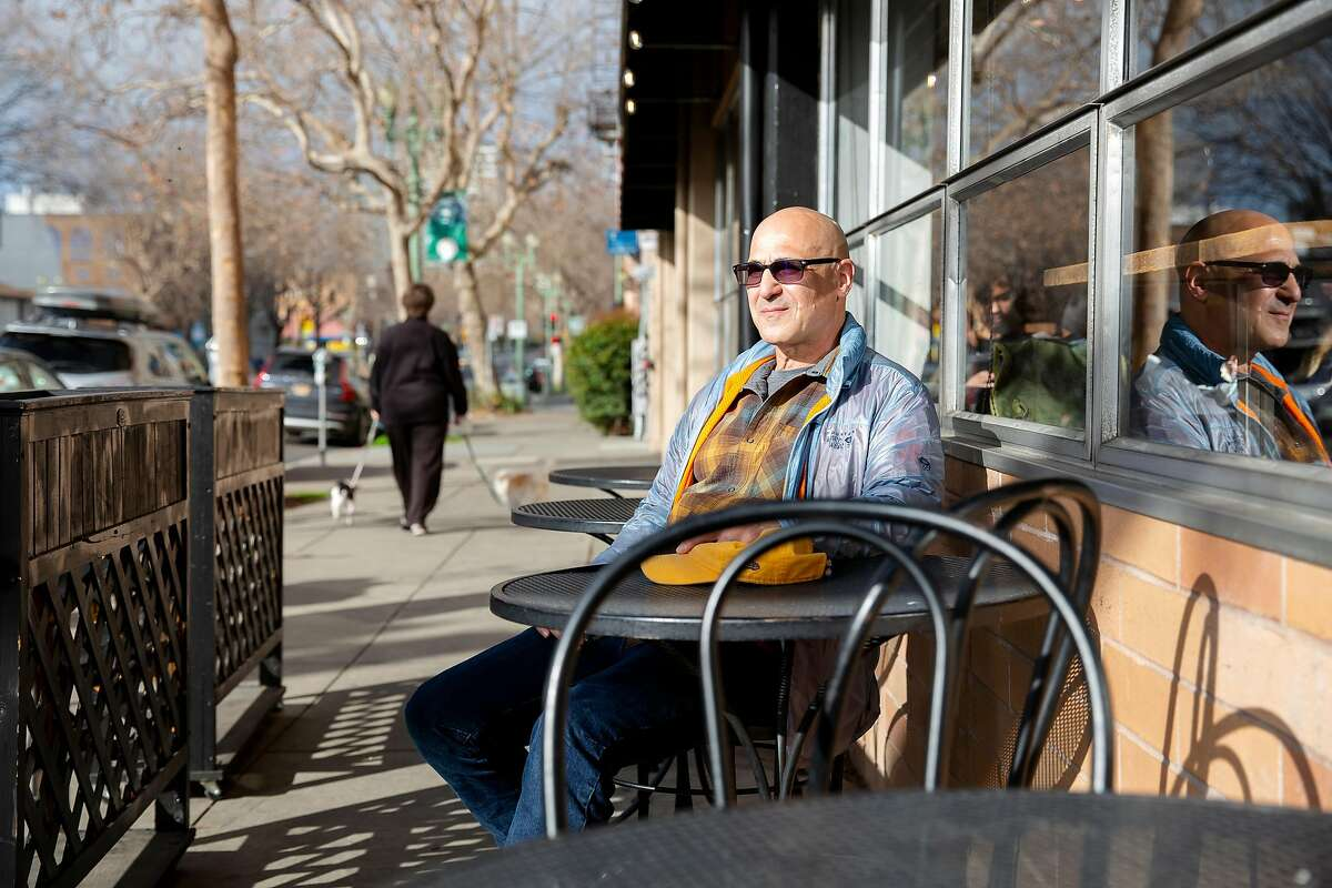 Randy Lyman sits outside of Perch, a local coffee shop he often frequents in Oakland, Calif. on Monday, January 27, 2020. Just across the street is the corner where Lyman was robbed at gun point just after midnight on January 18 at the corner of Grand Avenue and Bellevue Avenue in Oakland. After being punched in the face and held at gunpoint the robbers took both his wallet and phone before leaving in a nearby car. Lyman's robbery was one of many that have been occurring in Oakland involving getaway cars.