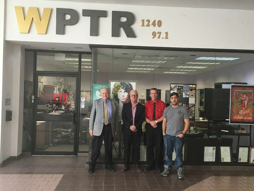 Offices of WPTR 1240 AM and 97.1 FM. From left, Jeff Clark, Randall Hogue Sr., Joe Kriss and Randy Hogue stand at the entrance to WPTR's studios.