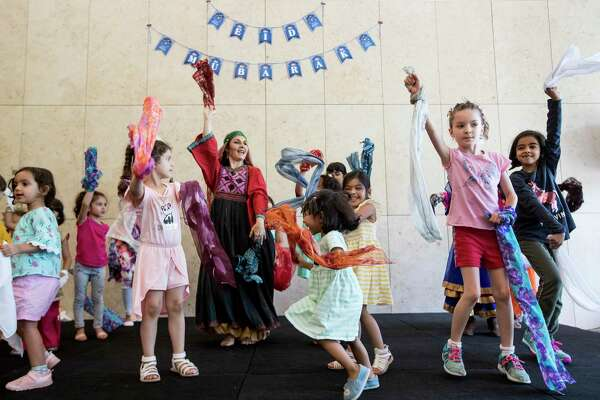 Kristina Koutsoudas teaches young children the Qashqai, a folk wedding dance from southern Persia during the Asia Society's inaugural Family Day Celebrating Eid.