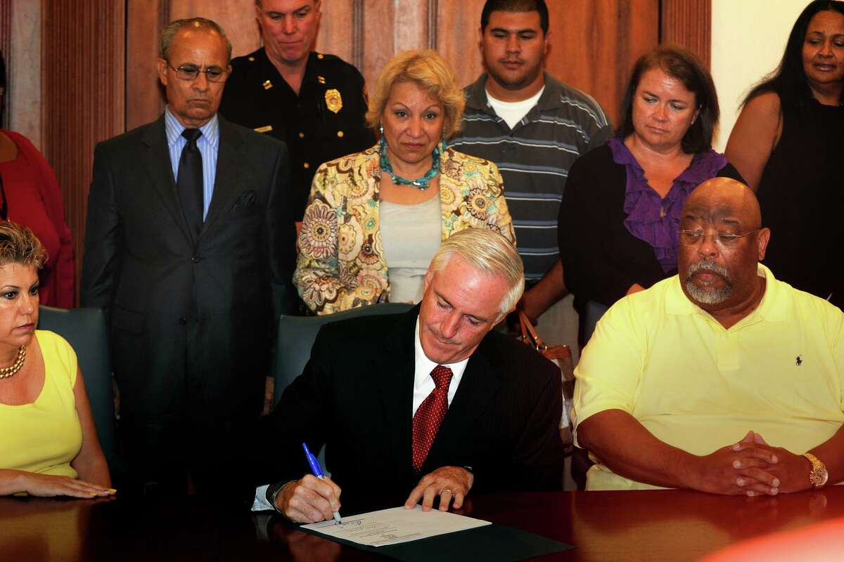 Mayor Bill Finch signs a curfew ordinance at the Margaret Morton Government Center, in Bridgeport, Conn. July 30th, 2012. The city has revived it following a spike in violence.