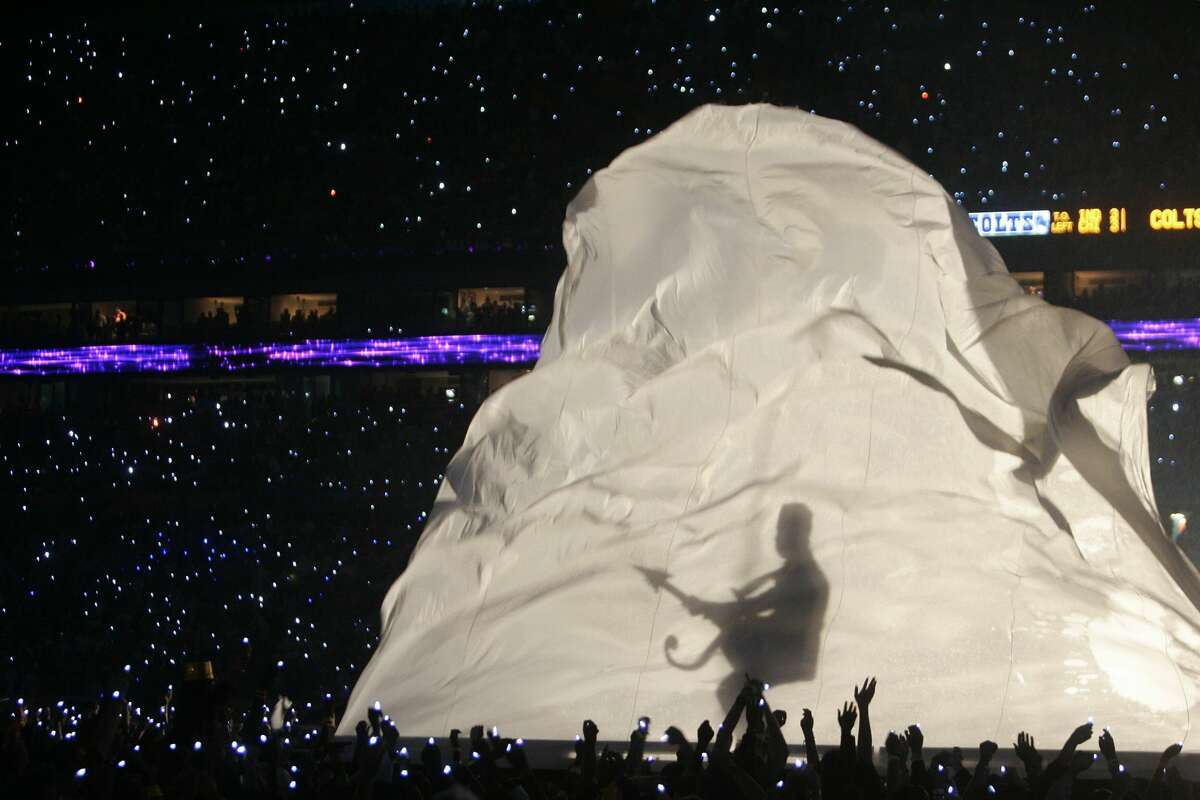 """13. Prince's """"guitar"""" shadow (2007) Prince's performance of """"Purple Rain"""" during a downpour at Super Bowl XLI is one of the most iconic Super Bowl moments of all-time, on or off the field. Despite the logistical nightmare, when Prince was told that it would be raining on the day of the show, heactually asked if they could make it rain harder. While the weather could've made for a disaster, it only amplified the energy. The one awkward moment happened during his introduction, when the backlit shadow of his signature guitar ... didn't look like a guitar at all."""