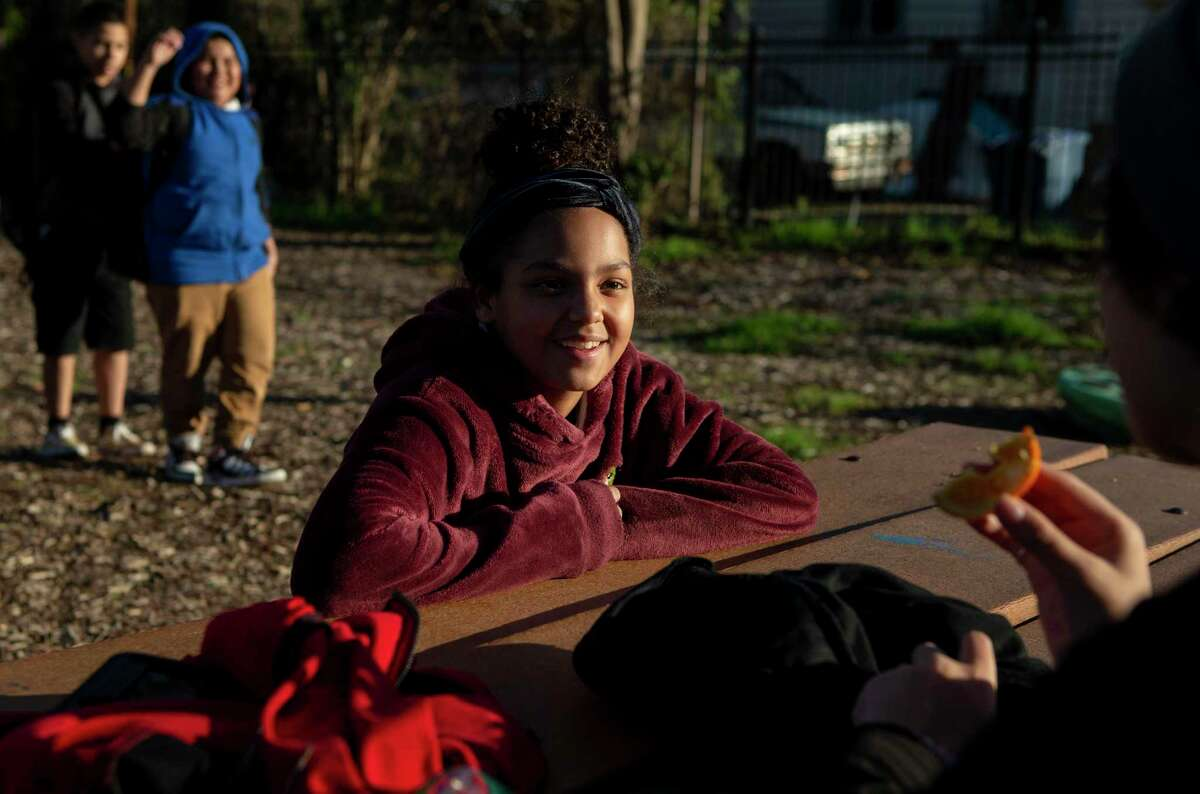 Rihanna Briseño, 12, talks with a friend in after-school programming at Good Samaritan Community Services on the West Side. She attended a class there last fall that UTSA piloted there to teach kids how they can overcome the effects of trauma by regulating emotions, managing stress, developing empathy, building a support system and more.