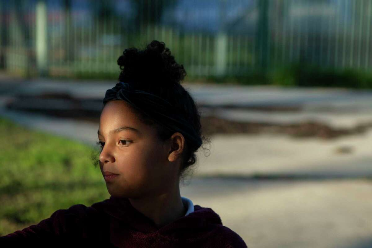 Rihanna Briseño, 12, wanders the playground during after-school programming at Good Samaritan Community Services on the West Side. She attended a class there last fall that UTSA piloted to teach kids how they can overcome the effects of trauma by regulating emotions, managing stress, developing empathy, building a support system and more.