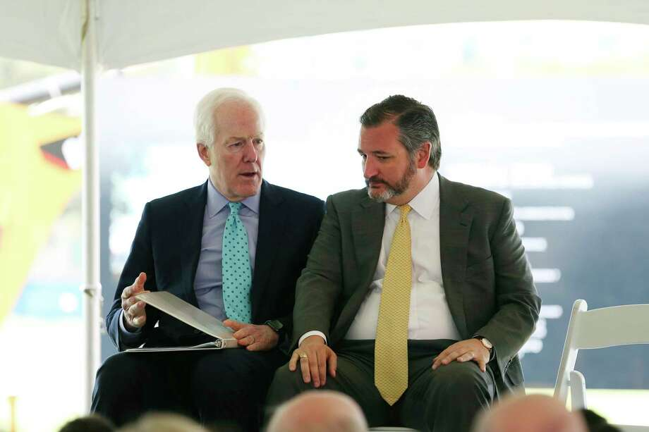 U.S. Sen. John Cornyn, left, talks with fellow Sen. Ted Cruz before the start of a ground breaking ceremony for the US Courthouse at the former site of the San Antonio Police Department on the 200 block of West Nueva Street, Monday, March 18, 2019. Photo: Jerry Lara / Staff Photographer / © 2019 San Antonio Express-News