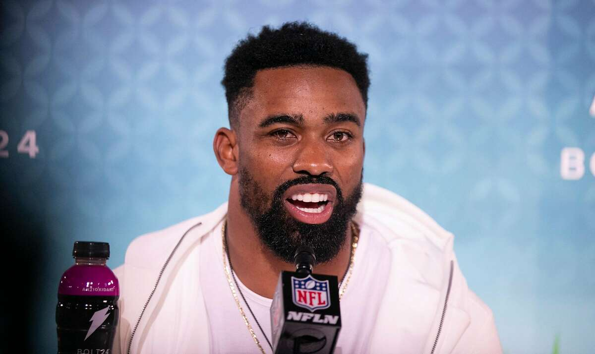 San Francisco 49ers running back Raheem Mostert (31) is interviewed by the media during Super Bowl Opening Night presented by BOLT24, the national kick off for Super Bowl LIV festivities at Marlins Park in Miami, Fla. (Al Diaz/MIami Herald/TNS)