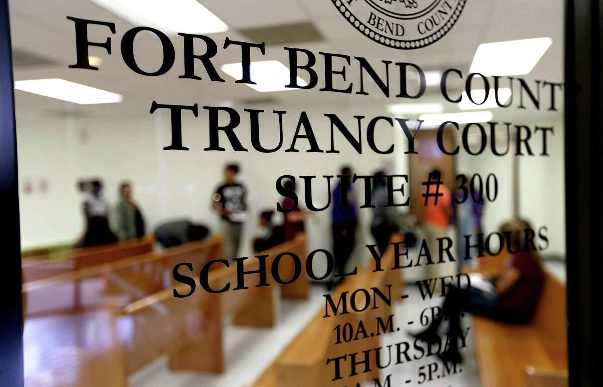 Juveniles form a line to enter the Fort Bend County Truancy Court Tuesday, March 3, 2015, in Sugar Land, Texas. The Texas legislature decriminalized truancy in 2015 and Fort Bend ISD then created a new process for truancy proceedings.