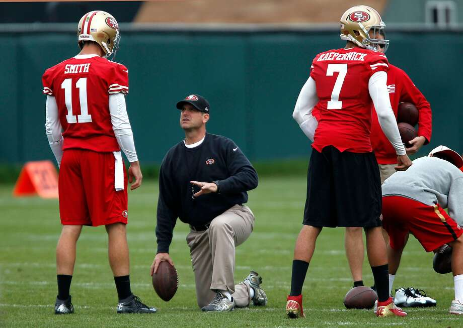 Head coach Jim Harbaugh (center) works with quarterbacks Alex Smith, (11) and Colin Kaepernick, (7), at a San Francisco 49ers practice in 2013. Photo: Michael Macor / The Chronicle 2013