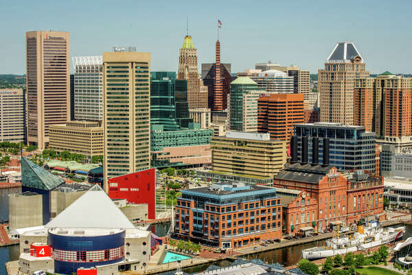 Maryland, Baltimore - Cityscape of the city of Baltimore and the harbor, popular Maryland attraction. (Photo by: Edwin Remsberg / VWPics/Universal Images Group via Getty Images)