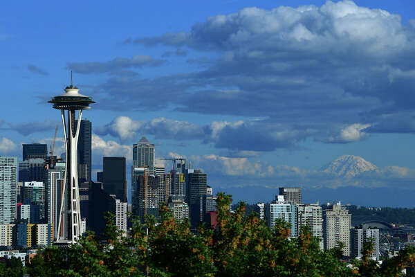 SEATTLE, WA - JUNE 8: A general view of the Seattle Space Needle and downtown skyline with Mount Rainier in the background leading up to the 2019 Rock'n'Roll Seattle Marathon and 1/2 Marathon on June 8, 2019 in Seattle, Washington. (Photo by Donald Miralle/Getty Images for Rock'n'Roll Marathon )