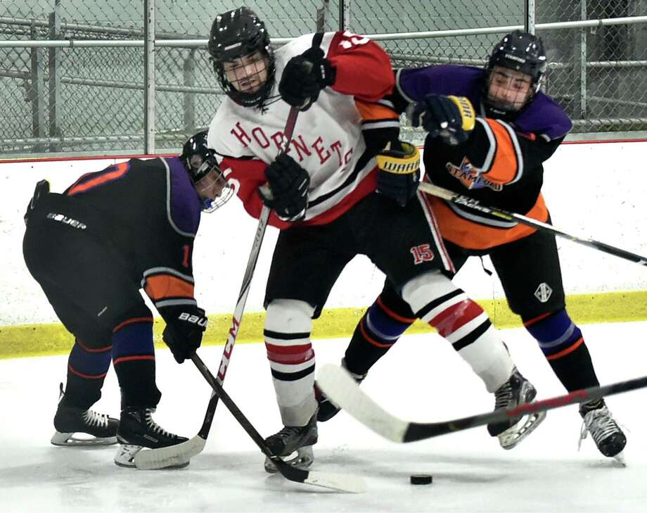Samford Co-Op's Santiago Gonzales, left, and Hunter Gilchrist, right, sandwich Branford's Daniel Farricelli during the first period Wednesday at the Northford Ice Pavilion. Photo: Peter Hvizdak / Hearst Connecticut Media / New Haven Register