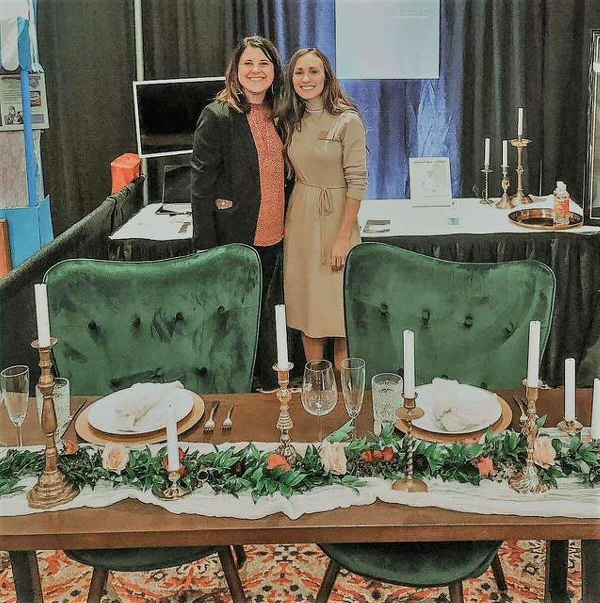 The Ink House owners Kristen Pfund, left, of Edwardsville, and Hannah Fink, of Glen Carbon, stand at the new venue's booth at the pair's first wedding show as vendors representing the event center. The downtown venue will host its first event for