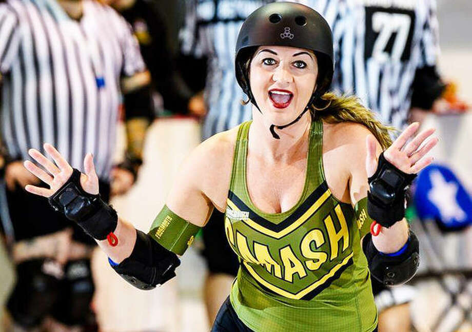 "Glen Carbon's Brandy ""Smash Money"" Turner, with Arch Rival Roller Derby's the Smashinistas."
