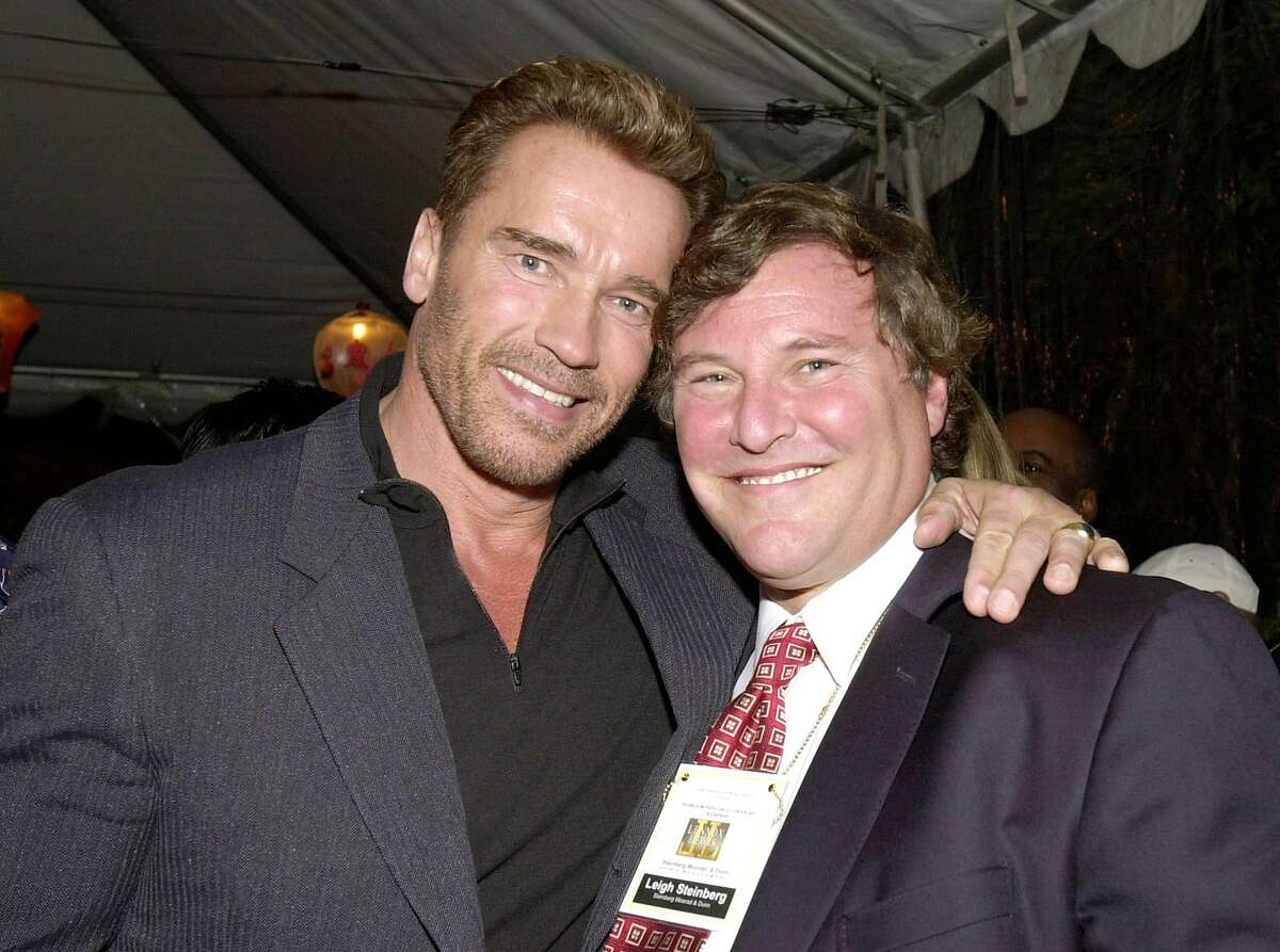 381892 10: ***EXCLUSIVE*** Actor Arnold Schwarzenegger, left, and sports agent Leigh Steinberg at a private party thrown by Steinberg and producer Brian Medavoy celebrating Lennox Lewis winning the title of heavyweight champion of the world at the Buffalo Club November 15, 2000 in Santa Monica, CA. (Photo by Chris Weeks/Liaison)