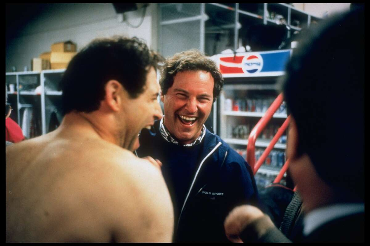 Sports agent Leigh Steinberg (C) sharing a laugh with star client, 49ers quaterback Steve Young (L) in lockerroom area. (Photo by Kim Komenich/The LIFE Images Collection via Getty Images/Getty Images)