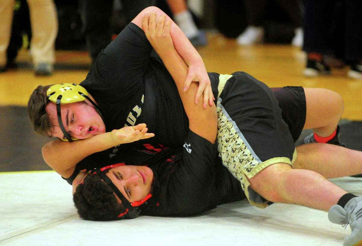 Trumbull's Abrahim Sakakini works to pin Fairfield Warde's Wyatt Morgan during high school wrestling action in Trumbull, Conn., on Wednesday Jan. 29, 2020.