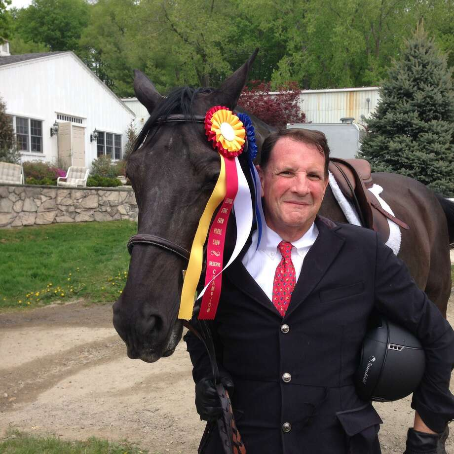 Westport's Bob Rose and Stepping Stone Farm's Rocky recently won the 2019 Championship ribbons of both the Child / Adult Jumper Division and the Low Training Jumper division of the Fairfield Westchester Professional Horsemen's Association. Photo: Submitted
