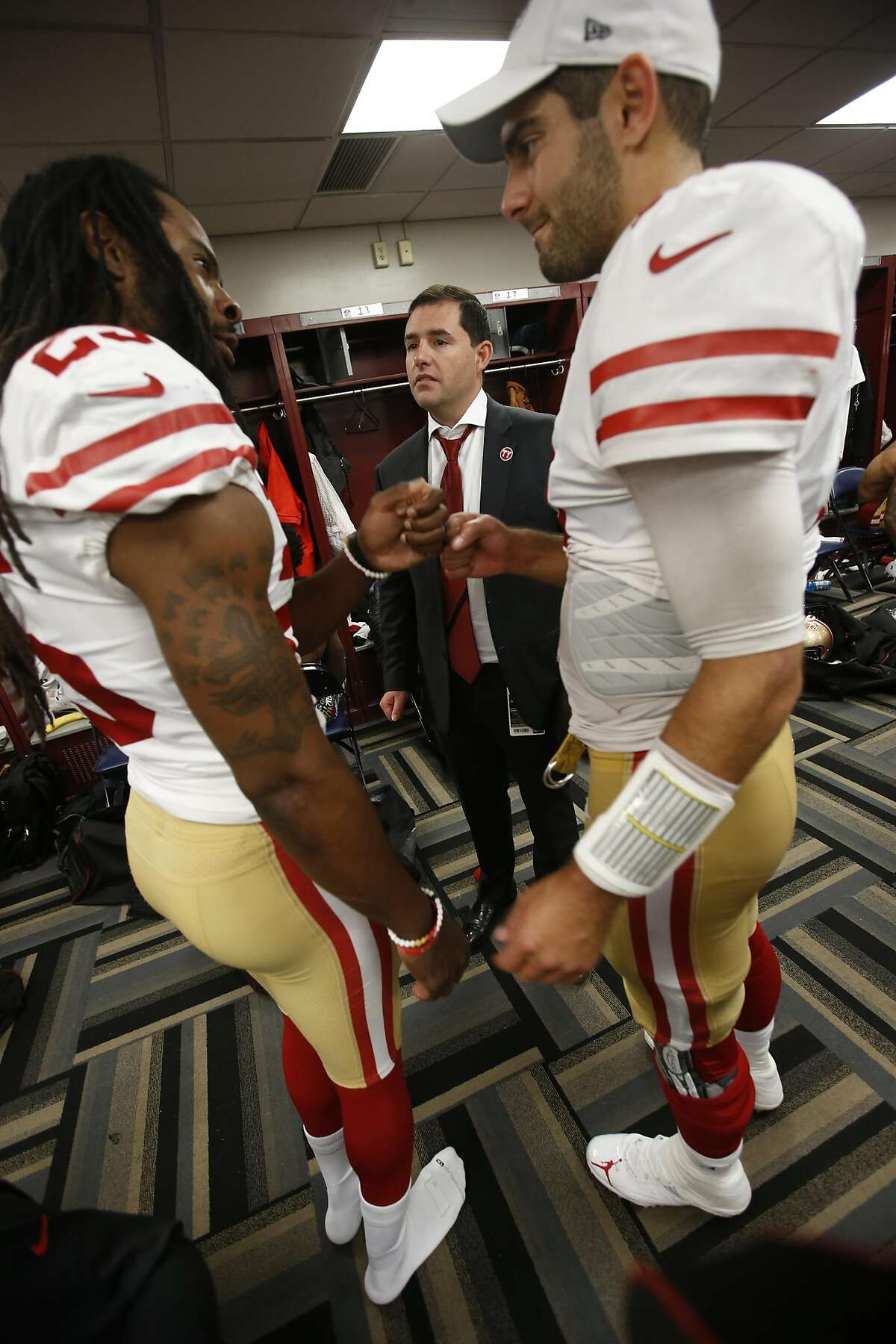 NEW ORLEANS, LA - DECEMBER 8: Richard Sherman #25, CEO Jed York and Jimmy Garoppolo #10 of the San Francisco 49ers celebrate in the locker room following the game against the New Orleans Saints at the Mercedes-Benz Superdome on December 8, 2019 in New Orl