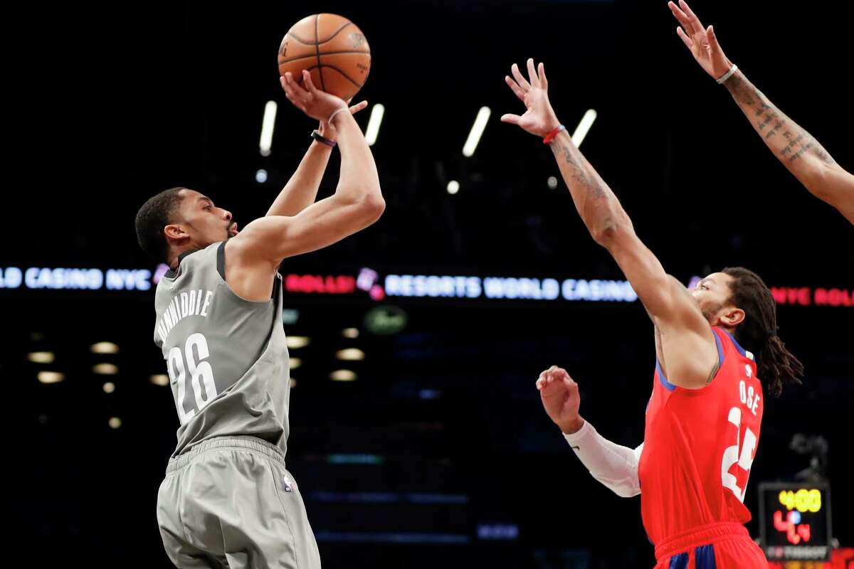 Brooklyn Nets guard Spencer Dinwiddie (26) shoots as Detroit Pistons guard Derrick Rose (25) defends him during the second half of an NBA basketball game, Wednesday, Jan. 29, 2020, in New York. The Nets defeated the Pistons 125-115 with Dinwiddie leading the Nets with 28 points. (AP Photo/Kathy Willens)
