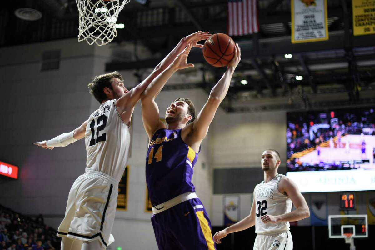 UAlbany's Adam Lulka goes to the basket against UMBC's Brandon Horvath during their America East game on Wednesday, Jan. 29, 2020. (Gail Burton / Special to the Times Union)