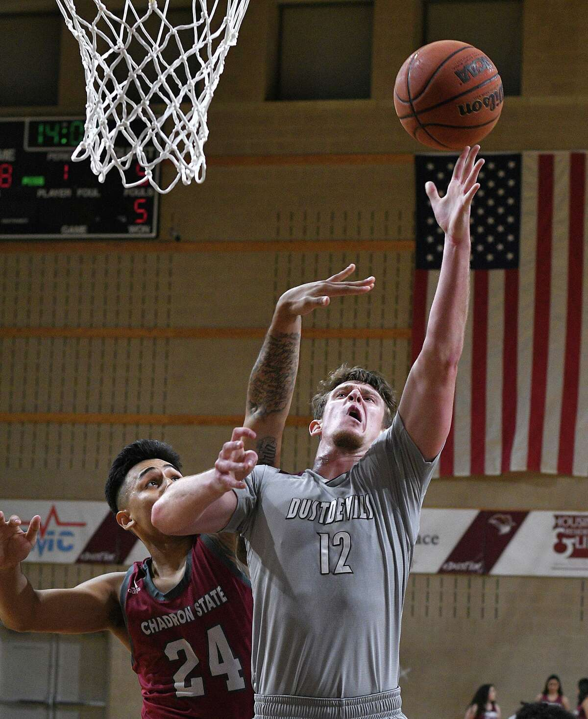 Tom Higgins goes for a basket for the TAMIU Dustdevils as they played Chadron State Friday at TAMIU.