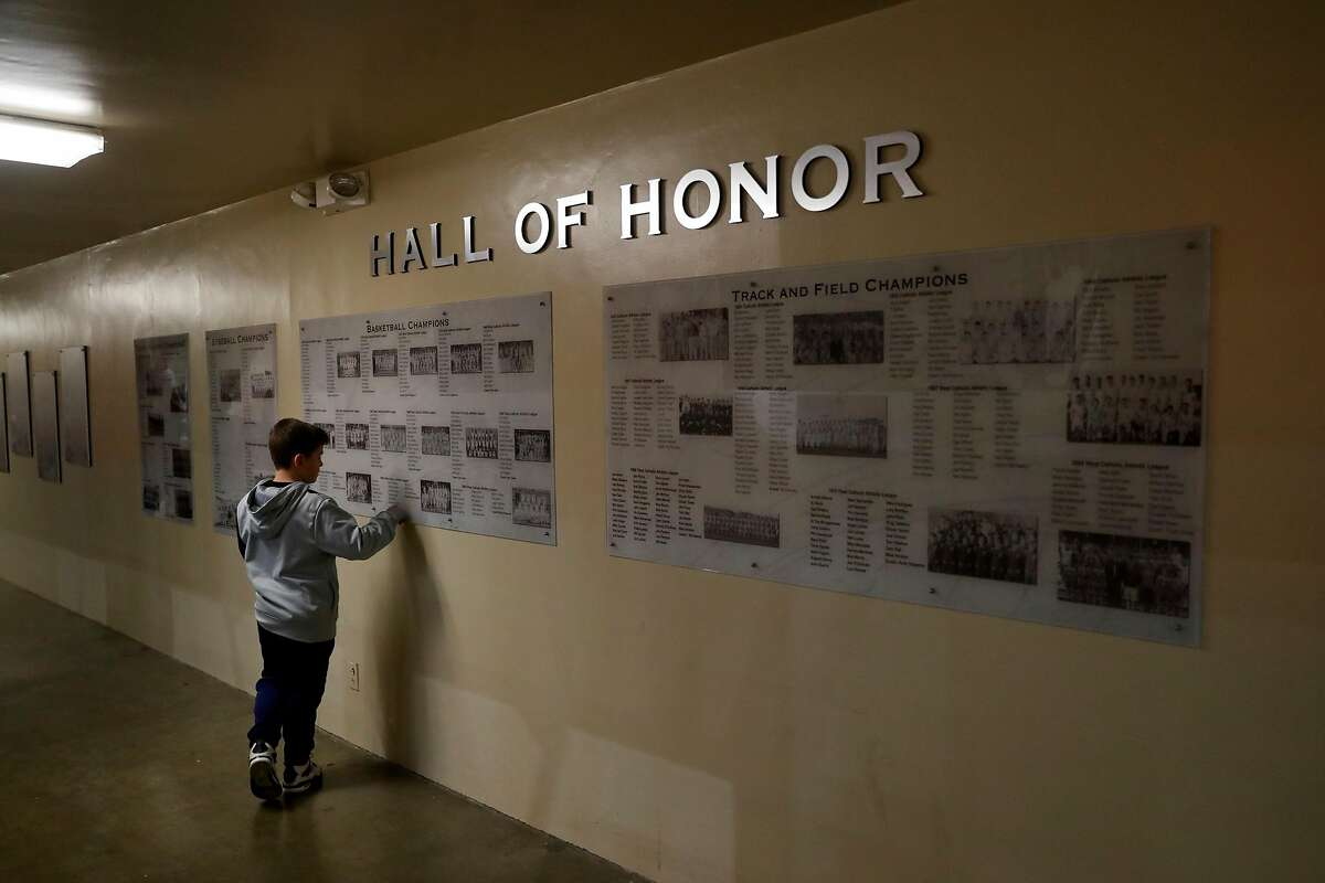 A young boy checks out the Hall of Honor at Archbishop Riordan High School gymnasium in San Francisco, Calif., on Tuesday, January 23, 2018.