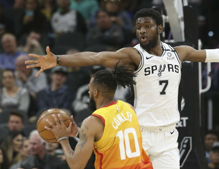 File photo of Spurs' Chimezie Metu as he defends against Utah Jazz's Mike Conley (10) during their game at the AT&T Center on Wednesday, Jan. 29, 2020. Photo: Kin Man Hui, Staff Photographer