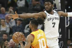 Spurs' Chimezie Metu (07) defends against Utah Jazz's Mike Conley (10) during their game at the AT&T Center on Wednesday, Jan. 29, 2020.