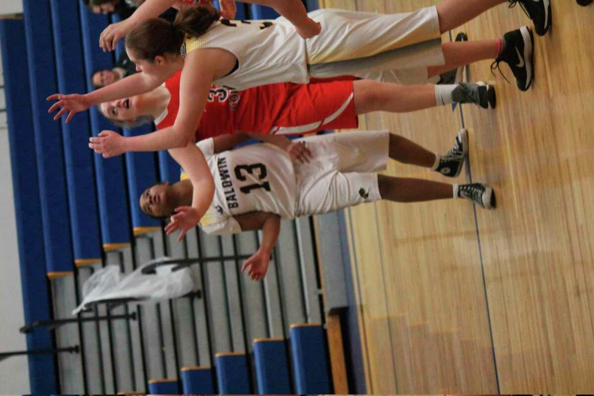 Baldwin girls, including Ja'Hyra Shannon (13), go after the ball in recent action. (Star photo/John Raffel)
