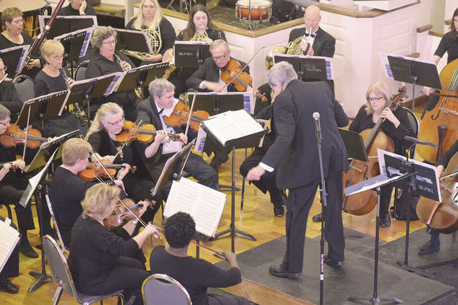Members of the Jacksonville Symphony Orchestra perform for hundreds of children in February. The symphony presents a performance each year for students to expose them to music. Photo: Journal-Courier