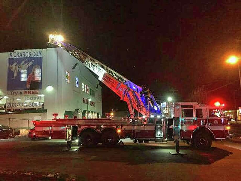 Firefighters and Eversource crews tracked down a odor of gas at the Federal Road building Wednesday night on Jan. 29, 2020. Crews found the odor was coming from with a roof top HVAC unit on top of the building. Photo: Danbury Fire Department Photo