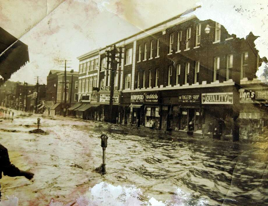 Main Street in Ansonia during the 1955 flood. Photo copied from the Derby Neck Library. Photo: Hearst File Photo