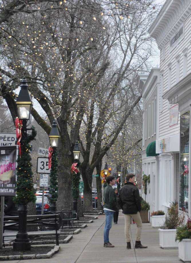 Ridgefield's Main Street with its shop-lined sidewalks and seasonal lights was attractive to shoppers this December, despite growing competition from online commerce, local retailers said. Photo: Macklin Reid / Hearst Connecticut Media