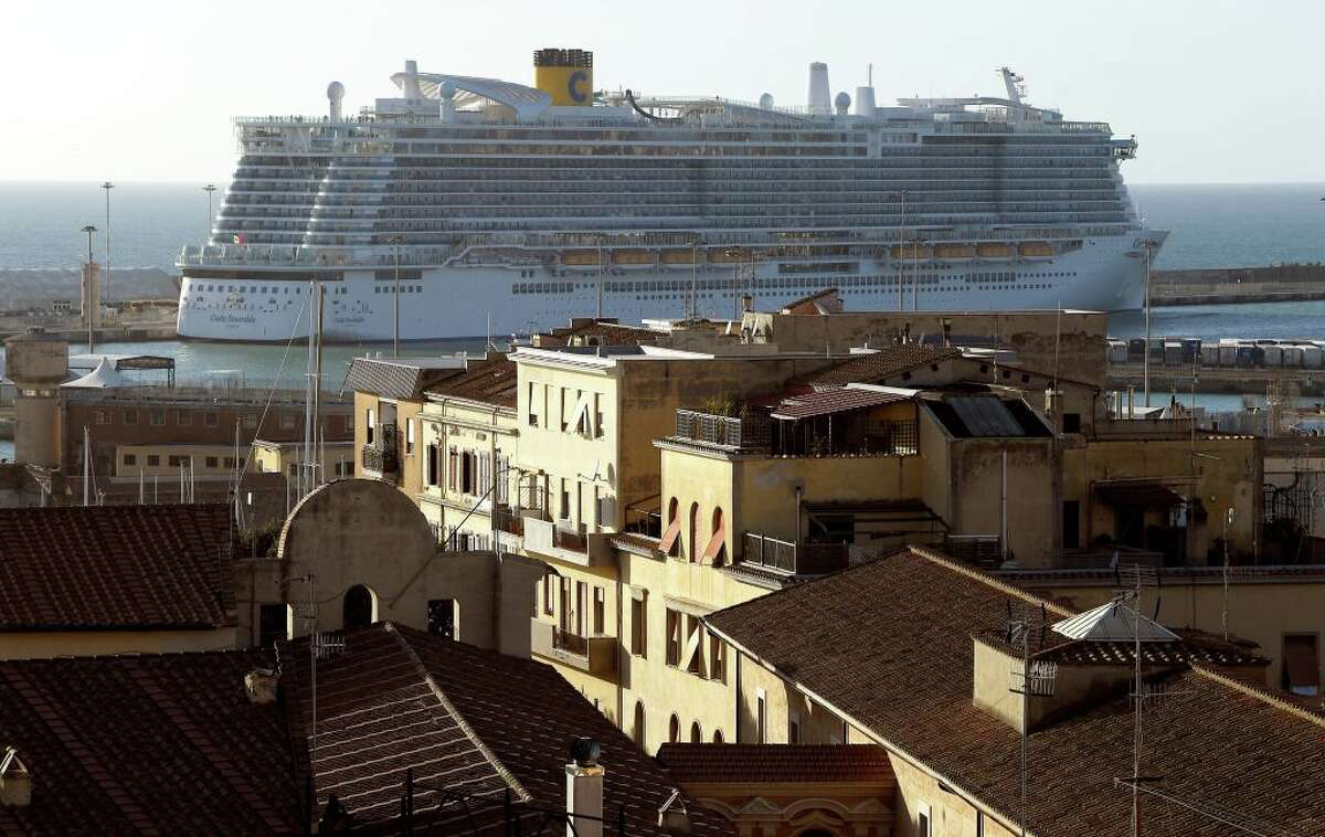 The Costa Smeralda cruise ship is docked in the Civitavecchia port 70km north of Rome on January 30, 2020. More than 6,000 tourists were under lockdown aboard the cruise ship after two Chinese passengers were isolated over fears they could be carrying the coronavirus. - Samples from the two passengers were sent for testing after three doctors and a nurse boarded the Costa Crociere ship in the port of Civitavecchia to tend to a woman running a fever, the local health authorities said. (Photo by Filippo MONTEFORTE / AFP) (Photo by FILIPPO MONTEFORTE/AFP via Getty Images)