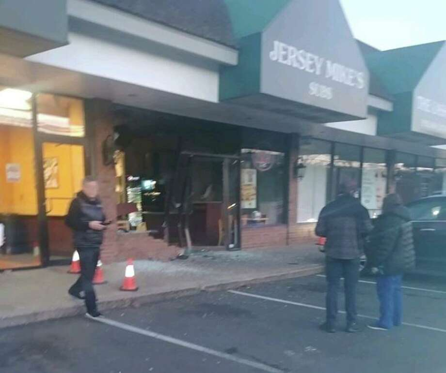 A car went into Jersey Mike's sandwich shop in Wilton early Thursday morning. Photo: Eric Fanwick