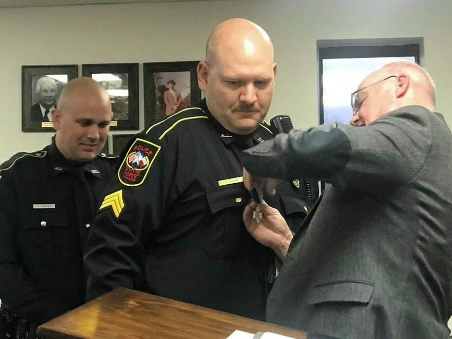 Willis Police Chief James Nowak presents the National Police Hall of Fame Life Saving Medal to Sgt. Jonathan Povsha at the Willis City Council meeting on January, 21, 2020. Photo: Meagan Ellsworth / Meagan Ellsworth