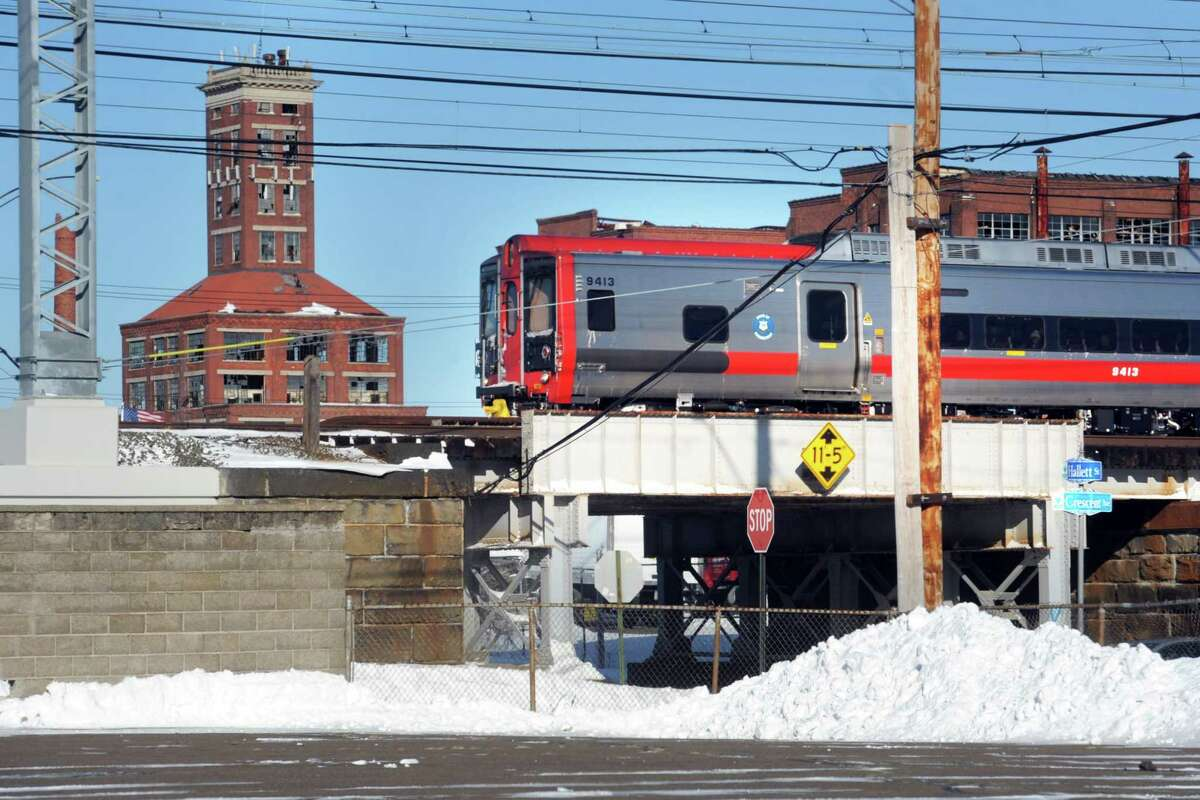 A Metro-North train passes through Bridgeport, Conn. Jan. 5, 2018, near the site of the proposed train station for the city's East Side.