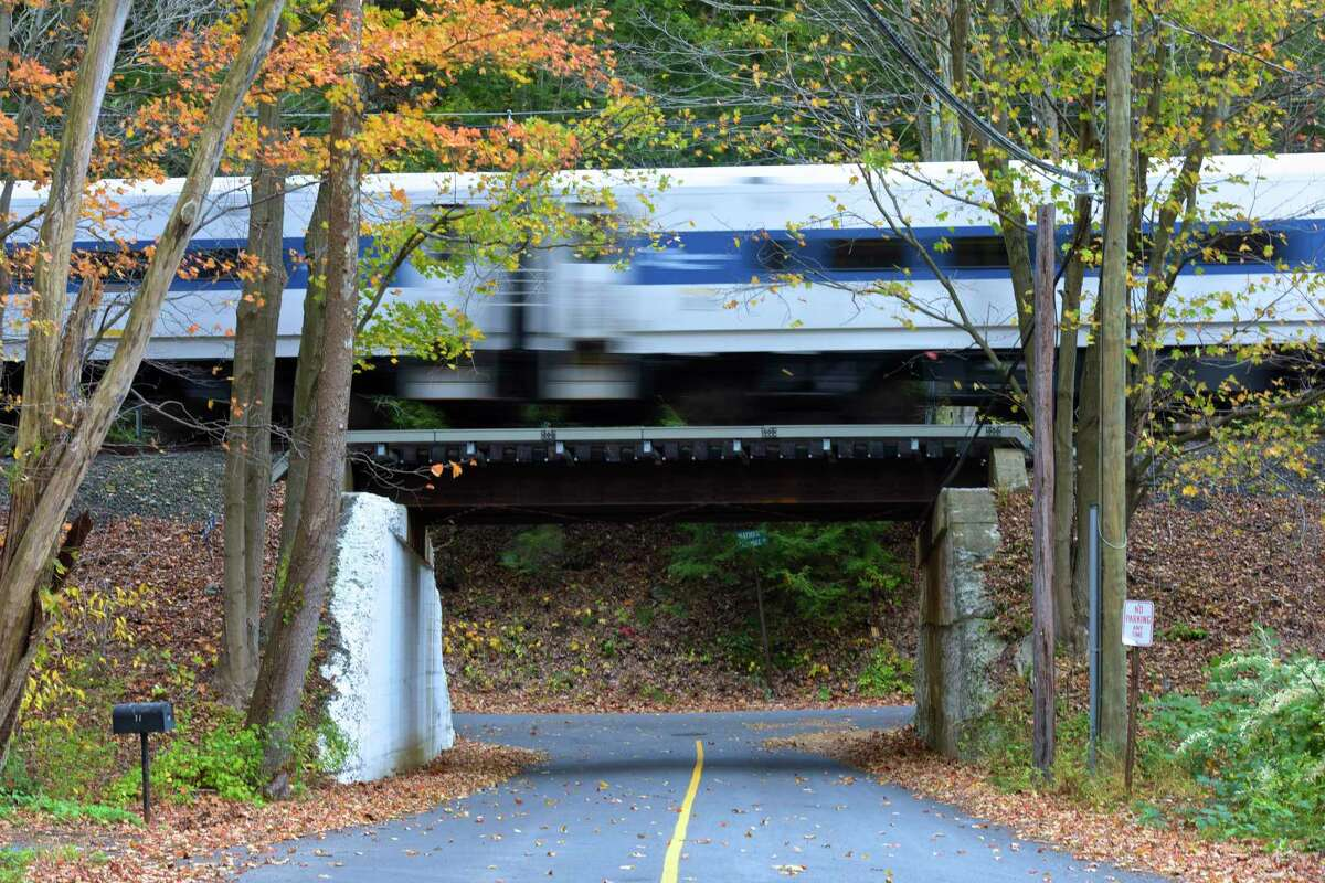 A Metro North commuter train heads south on the Danbury line, crossing over Old Mill Road, in Wilton, Conn, on Thursday, October 26, 2017.