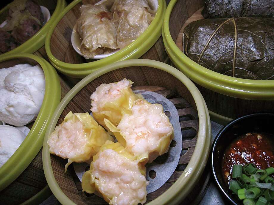 Dim sum options include shrimp shumai dumplings, char siu pork bao, meatballs, sin jok rolls in tofu skin and nor mai gai wrapped in lotus leaves at Golden Wok. Photo: Mike Sutter /Staff