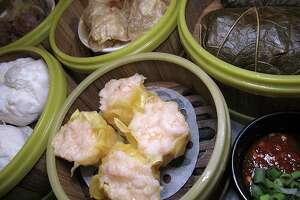 Dim sum options include shrimp shumai dumplings, char siu pork bao, meatballs, sin jok rolls in tofu skin and nor mai gai wrapped in lotus leaves at Golden Wok.
