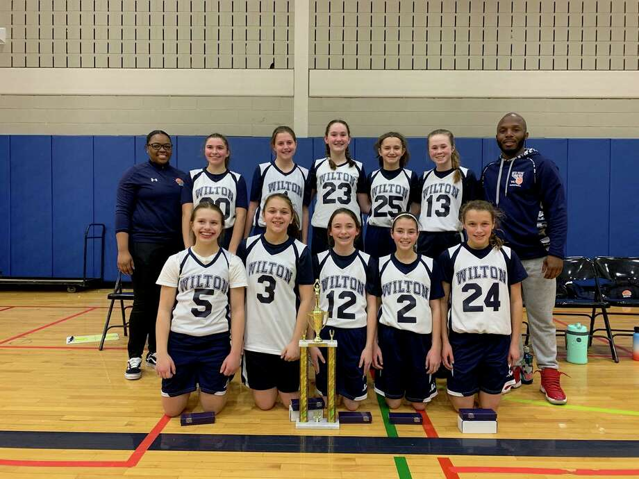 The Wilton 7th grade girls travel team went 5-0 and won the recent New Castle MLK Tournament. Top row (left to right): Coach Khea Gibbs, Mia Sommer, Abby Phelan, Addison Von Loeser, Sophia Samai, Grace Ratcliffe, coach Anthony Simmons; bottom row: Giuliana Scaturchio, Grace Costa, Abbey Byrnes, Riley Casey, Kaitlyn Zizzadoro. Photo: Contributed Photo / Wilton Basketball Association