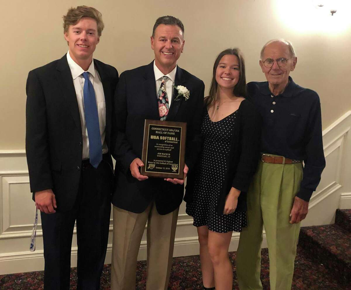 Westport's Jeb Backus with his family during the induction ceremony for the USA Softball Connecticut Hall of Fame.