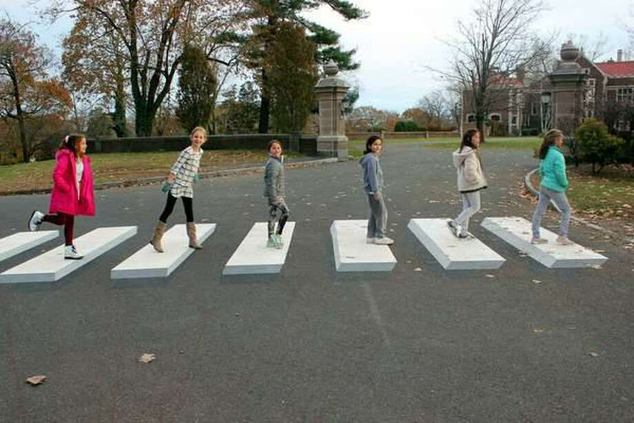 Girl Scouts Kathryn Iacono, Stella Heijens, Madison Ruggieri, Treasure Hudson, Ella Ferrer and Kate Beuerlein test a 3D crosswalk they got installed in Waveny Park in New Canaan recently. Photo: Contributed Photo / New Canaan Advertiser Contributed