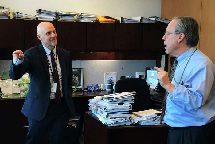 FDA commissioner Stephen Hahn (left) and Mitch Zeller, director of the agency's Center for Tobacco Products, discuss vaping and tobacco issues.