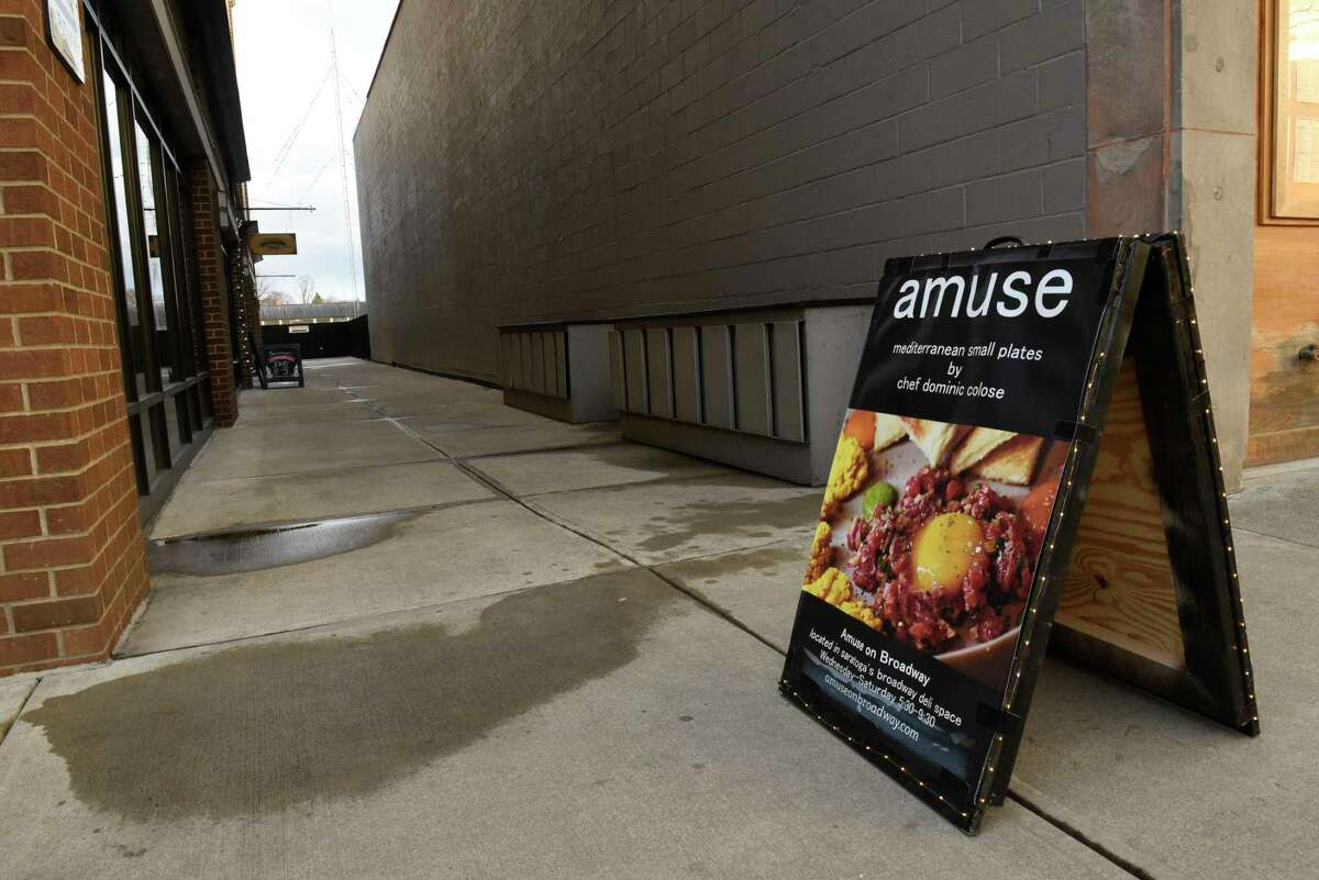 Sandwich board sign on Broadway at alley for Amuse on Broadway restaurant on Thursday, Jan. 16, 2020 in Saratoga Springs, N.Y. (Lori Van Buren/Times Union)