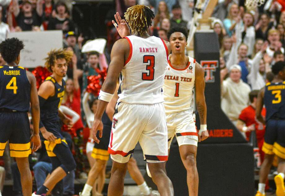 Texas Tech's Terrence Shannon Jr. (1) celebrates with Jahmi'us Ramsey after Ramsey hit a 3-pointer in the first half of their Big 12 Conference men's basketball game against West Virginia on Wednesday, Jan. 29, 2020 in the United Supermarkets Arena in Lubbock. Photo: Nathan Giese/Planview Herald