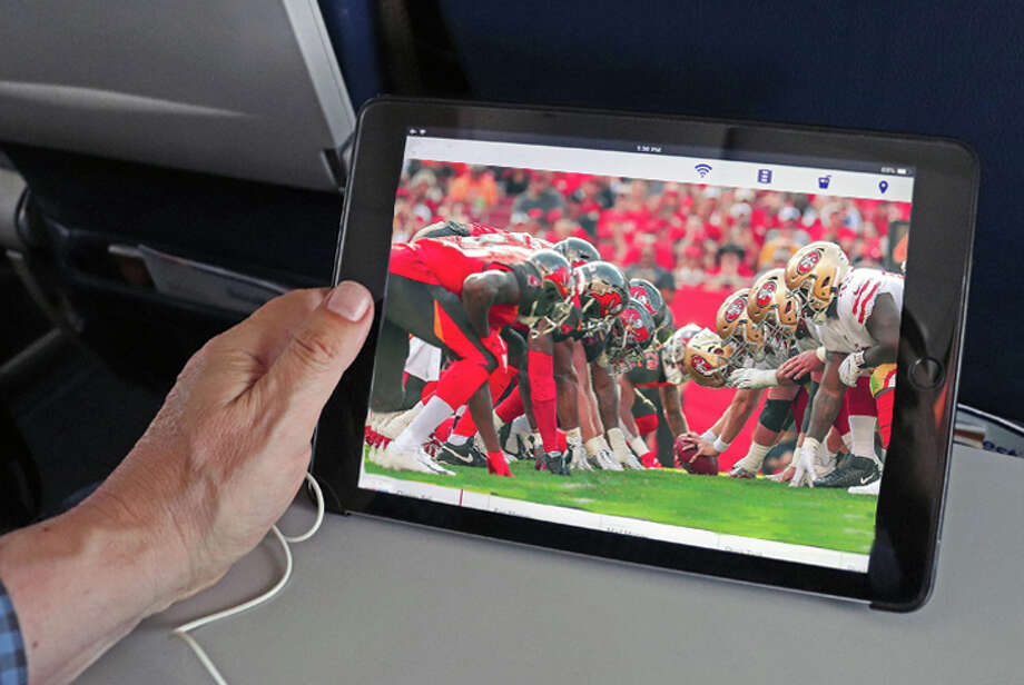 Streaming to personal devices is getting more popular on some airlines. Photo: Jim Glab