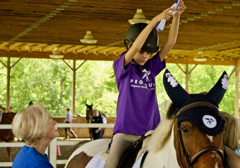 Learn how equine assisted activities positively benefit the cognitive, physical, emotional and social well-being of individuals with special needs when Lynn Peters, Volunteer Director of Pegasus, visits the Fairfield Library on Feb. 20. Photo: Fairfield Library / Contributed Photo