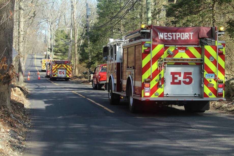Westport fire trucks alongside Broad Street handled a fire reported at a residence on Crooked Mile Road in Westport on Jan. 30, 2020. Photo: DJ Simmons /Hearst Connecticut Media /